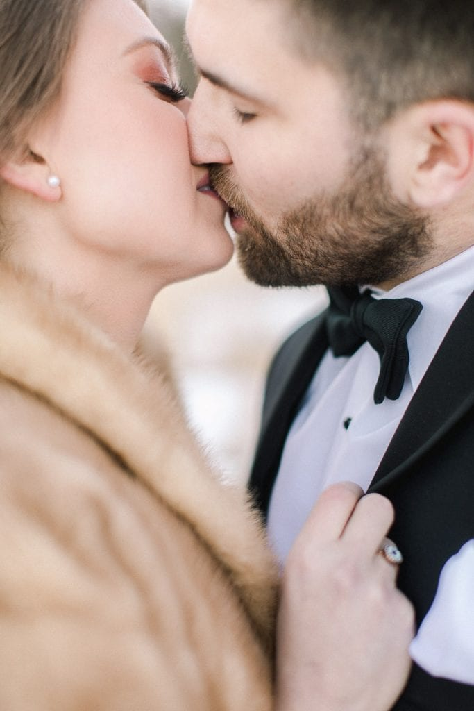 Calgary wedding photography-Silvertip New years eve wedding canmore couple kiss