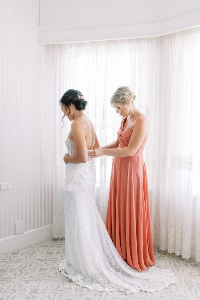 A Norland Estate Wedding Calgary wedding photographer getting ready