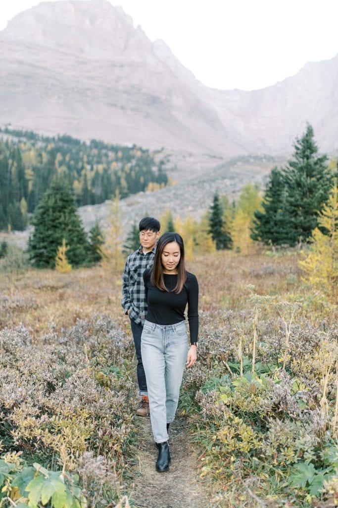 Banff fall engagement session couple portrait walking