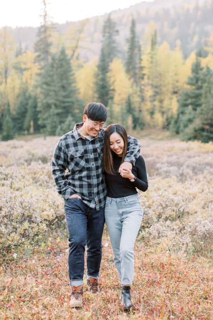 Banff fall engagement session couple portrait laughing