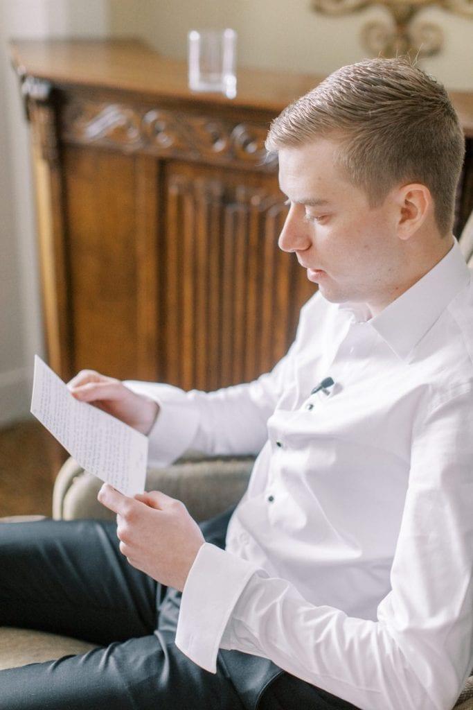 Banff wedding photography groom reading card
