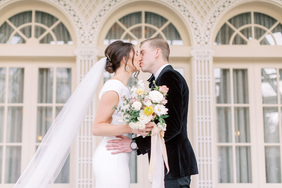 Banff wedding photography  first look with couple kissing