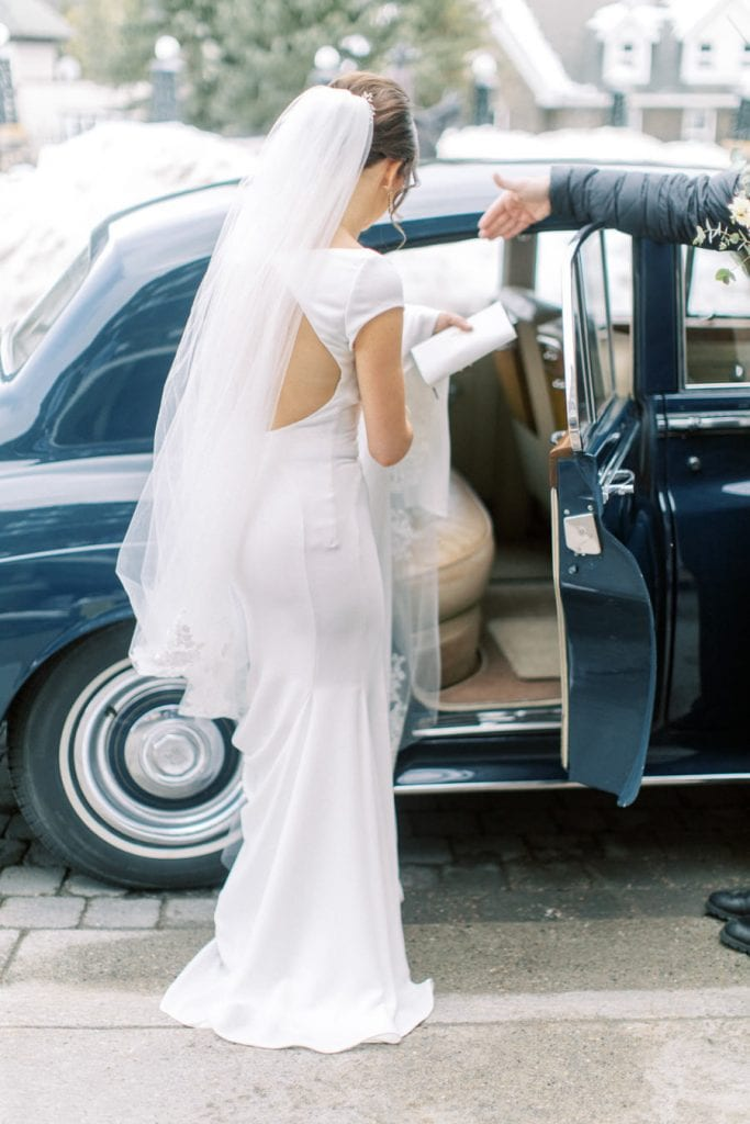 Banff wedding photography bride getting into car alpine limo service