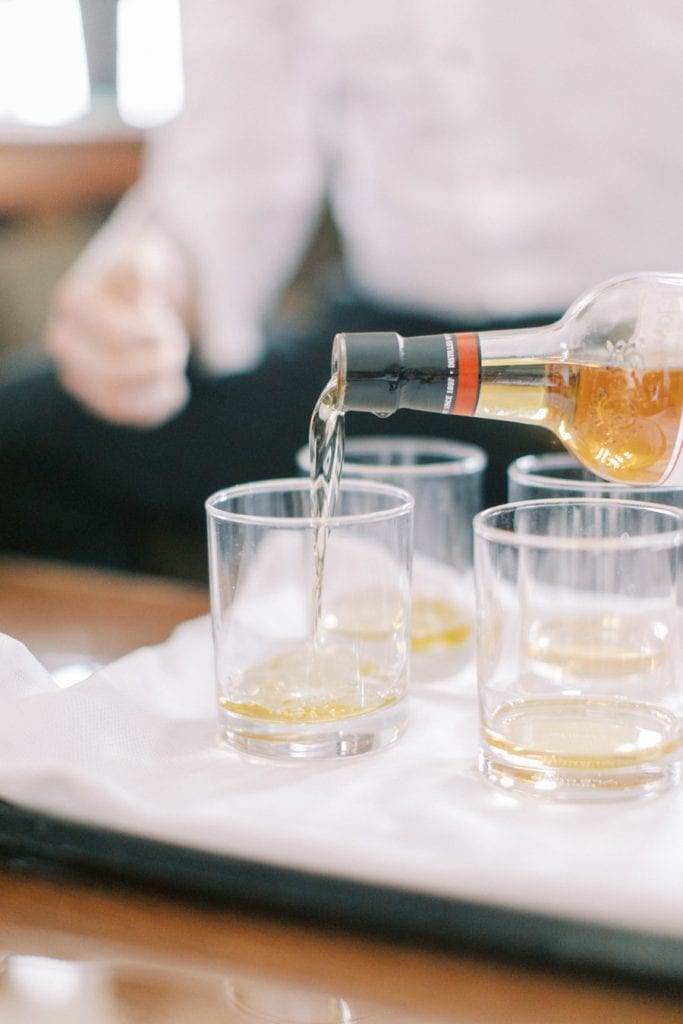 Banff wedding photography groom drink