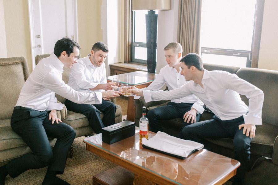 Banff wedding photography groomsmen drinking
